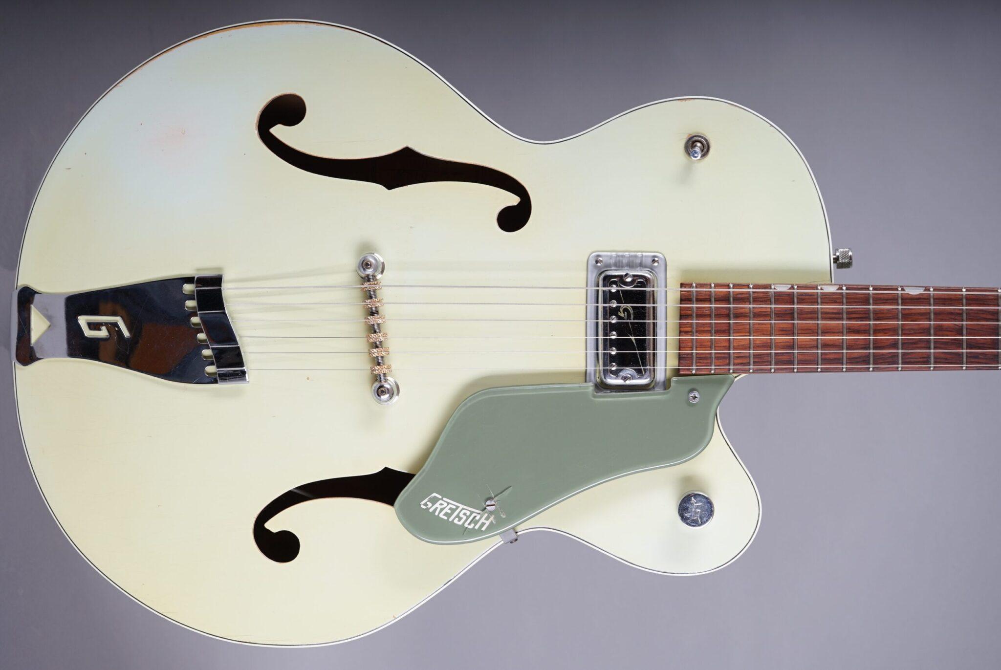 https://guitarpoint.de/app/uploads/products/1960-gretsch-6125-anniversary-2-tone-smoke-green/1960-Gretsch-6125-Anniversary-Green-35772-2q-scaled-2048x1371.jpg