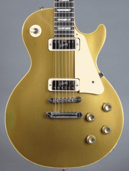 https://guitarpoint.de/app/uploads/products/1971-gibson-les-paul-deluxe-goldtop-640969/1972-Gibson-Les-Paul-Deluxe-Goldtop-640968-2-437x576.jpg