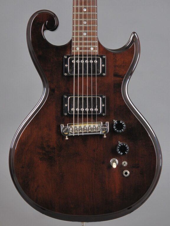 https://guitarpoint.de/app/uploads/products/1976-epiphone-scroll-sc450-walnut/1976-Epiphone-SC450-Scroll-Mahogany-2-576x768.jpg