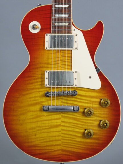 https://guitarpoint.de/app/uploads/products/2007-gibson-les-paul-1959-reissue-vos-washed-cherry/2007-Gibson-Les-Paul-1959-Reissue-VOS-97579-2-431x576.jpg