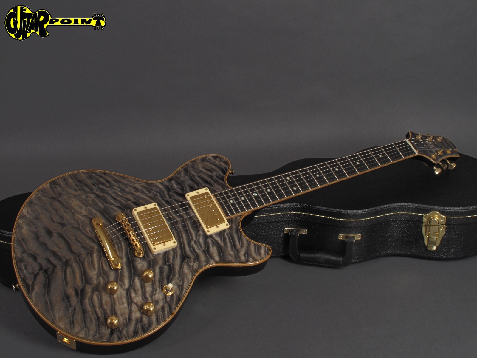 https://guitarpoint.de/app/uploads/products/sugi-model-sa605e-em-lc-trans-grey/Sugi_SA605_S900079_4.jpg